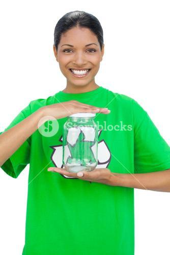 Cheerful model wearing recycling tshirt holding glass pot