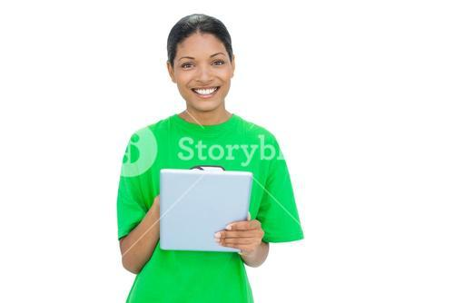 Cheerful model wearing recycling tshirt holding tablet