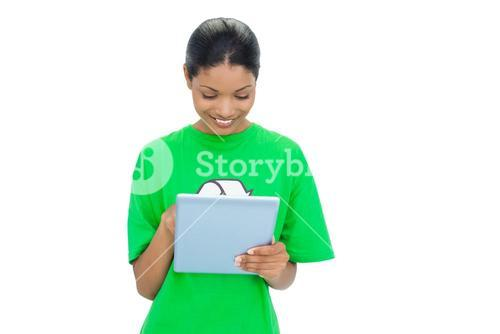 Smiling model wearing recycling tshirt holding tablet
