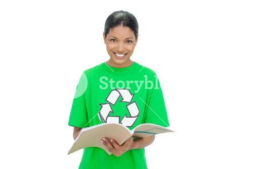 Smiling model wearing recycling tshirt holding notebook
