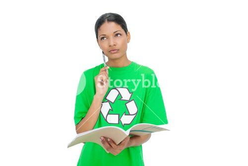Thoughtful model wearing recycling tshirt holding notebook