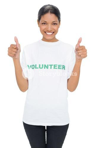 Smiling model wearing volunteer tshirt giving thumbs up