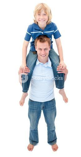 Lively father giving his son piggyback ride
