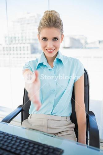 Cheerful classy businesswoman offering hand