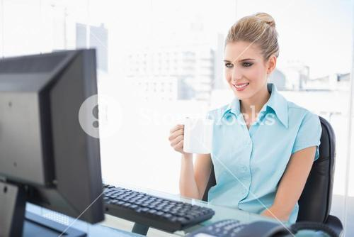 Cheerful well dressed businesswoman holding coffee
