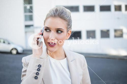 Pensive stylish businesswoman having a phone call