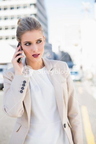 Pensive gorgeous businesswoman having a phone call