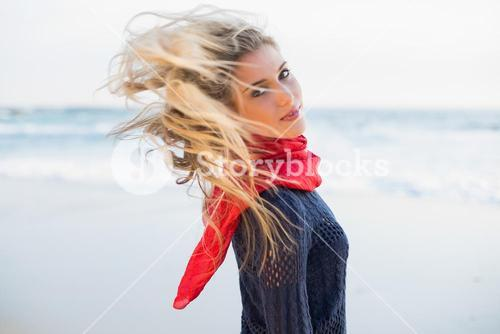 Gorgeous sexy blonde tossing her hair