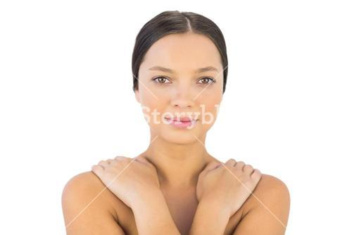 Attractive woman hands on shoulder smiling at camera