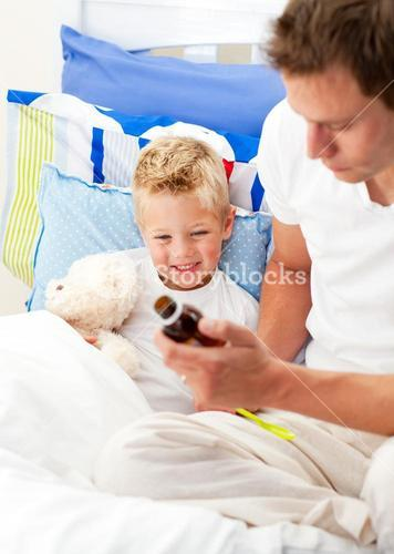 Caring man looking after his sick son