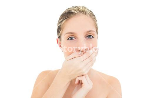 Pretty fresh blonde woman covering her mouth