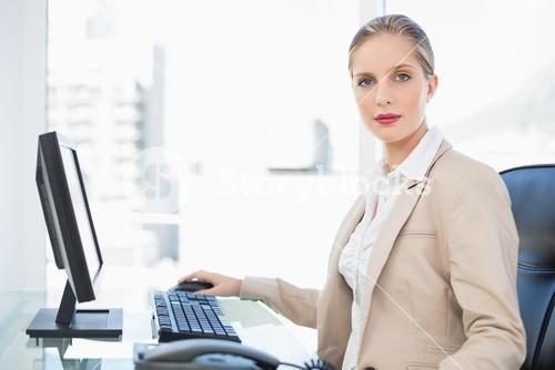 Peaceful blonde businesswoman posing