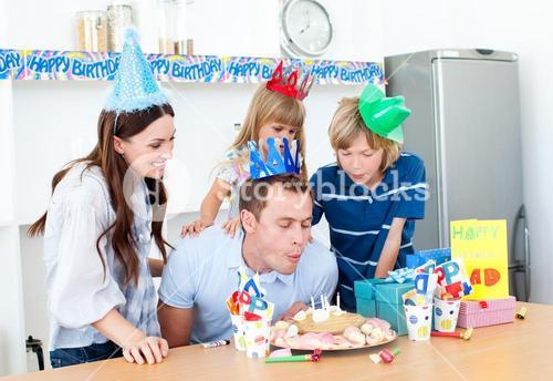 Elegant man celebrating his birthday with his wife and his children