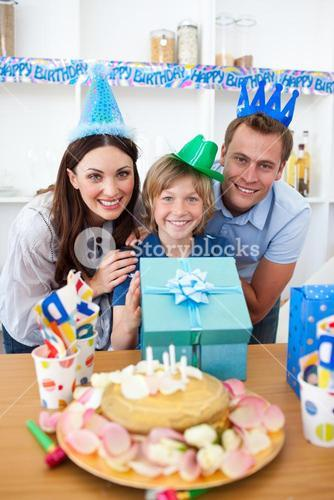 Lively parents celebrating their sons birthday