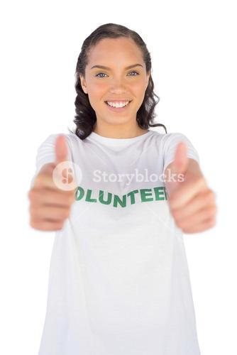 Woman wearing volunteer tshirt and giving thumb up