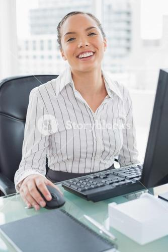 Happy buinesswoman working on computer