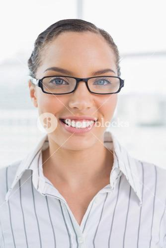 Smart smiling businesswoman with glasses