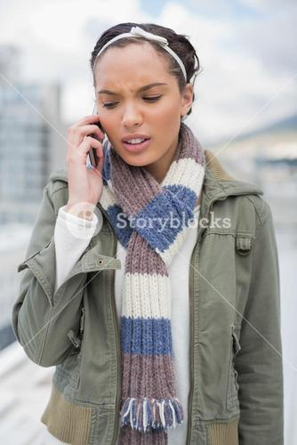 Angry woman talking on phone