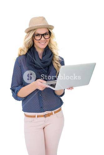 Cheerful trendy blonde holding laptop