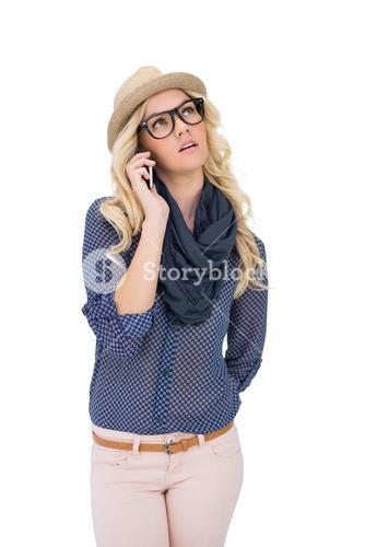 Thoughtful trendy blonde on the phone