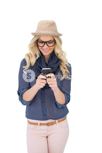 Smiling trendy blonde text messaging