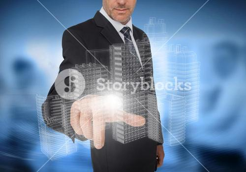 Businessman touching holographic faint city