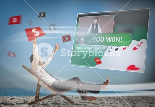 Businessman sitting on deck chair looking at holographic screen