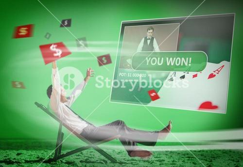 Businessman sitting on deck chair looking at holographic screen in green light