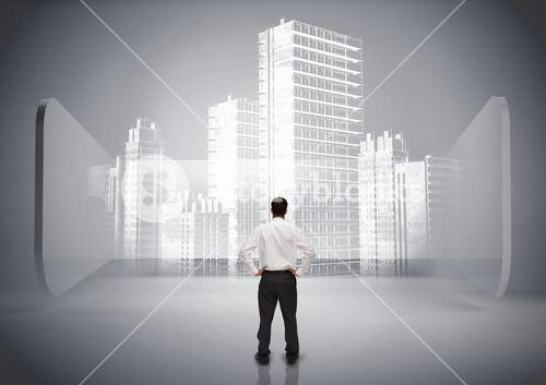 Rear view of businessman looking at holographic city