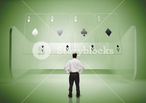 Rear view of businessman looking at holographic cards in green light