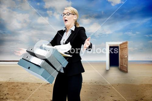 Frustrated businesswoman dropping folders