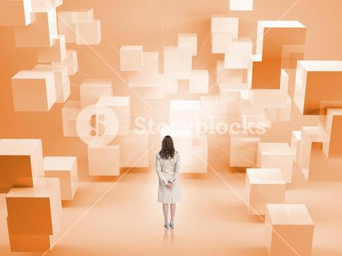 Rear view of businesswoman standing in room with orange blocks