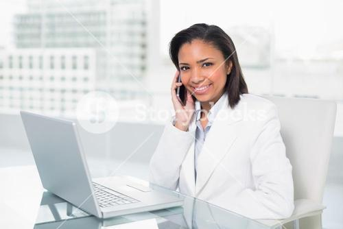 Stylish young dark haired businesswoman making a phone call