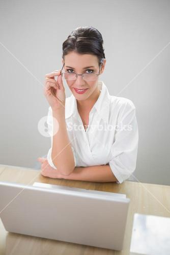 Smiling businesswoman with classy glasses posing
