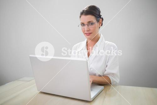 Cheerful businesswoman with classy glasses posing