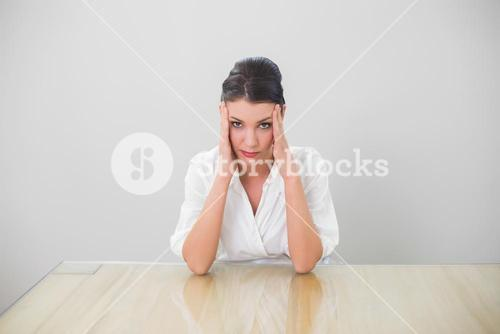 Anxious brown haired businesswoman posing