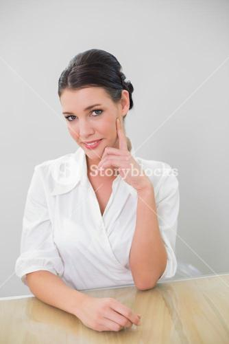 Cheerful brown haired businesswoman posing