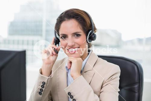 Content businesswoman touching headset