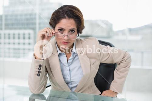 Dubious businesswoman looking at camera