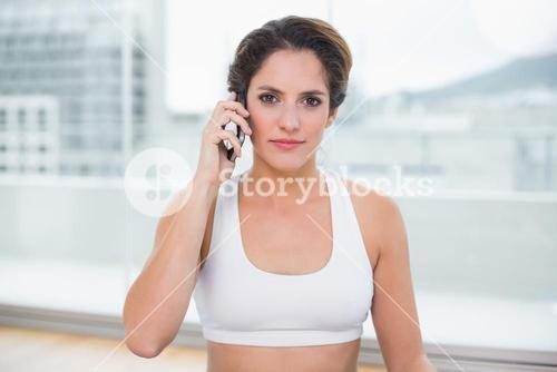 Sporty content brunette phoning