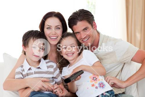 Portrait of a happy family watching TV