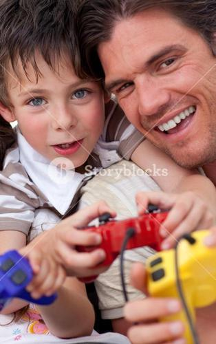 Portrait of a happy father and his son playing video games