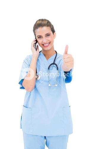 Cheerful brown haired nurse in blue scrubs making a phone call and raising her thumb