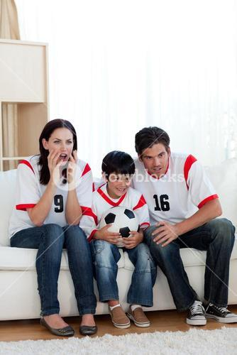 Concentrated family watching football match