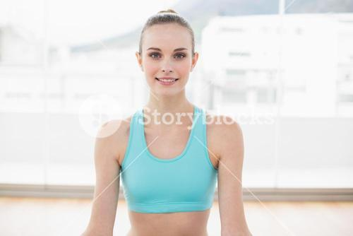 Sporty smiling woman sitting