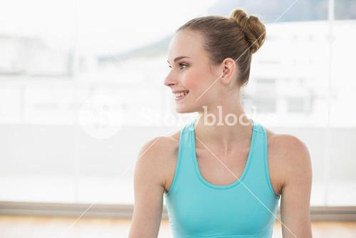 Sporty smiling woman looking away