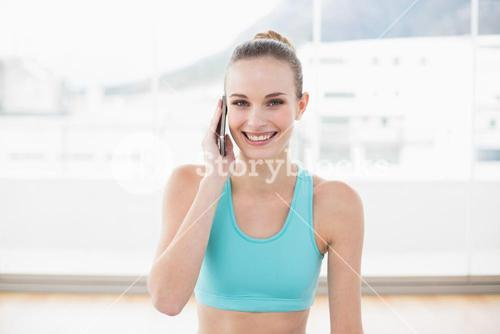 Sporty cheerful woman phoning