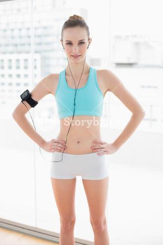 Sporty content woman listening to music