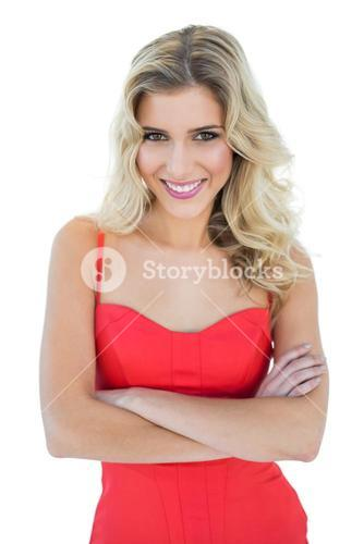 Smiling blonde model posing with arms crossed