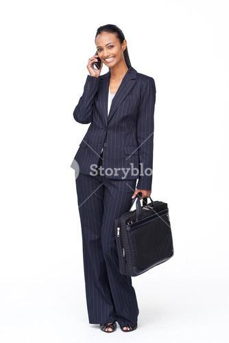 Beautiful businesswoman on phone going to work